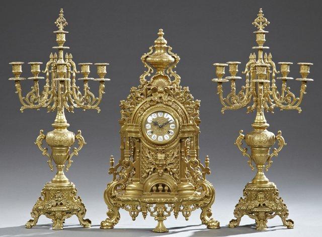 Louis XV Style Brass Three Piece Clock Set, 20th c.,