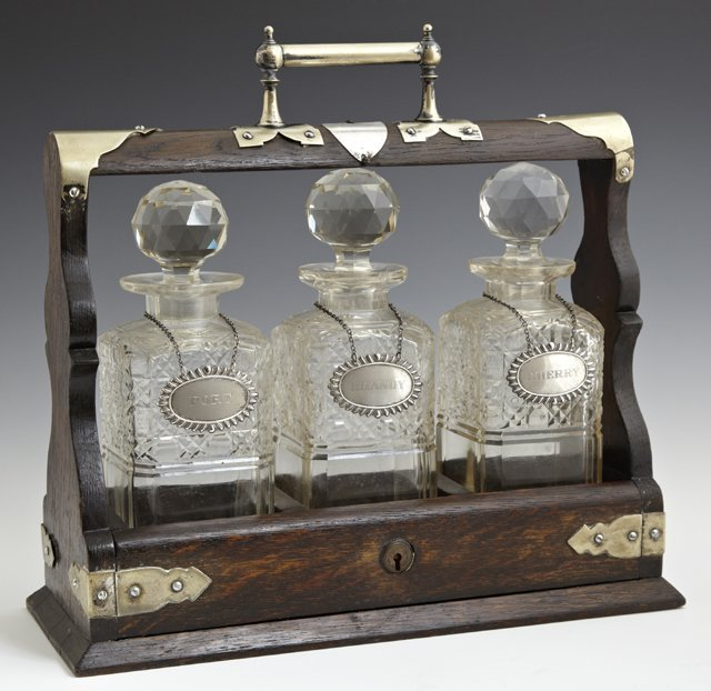 English Carved Oak Tantalus Set, 19th c., with three