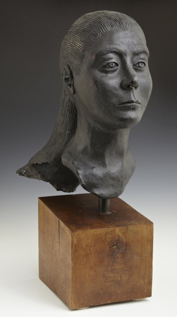 Ebonized Terra Cotta Bust, 20th c., of a woman with