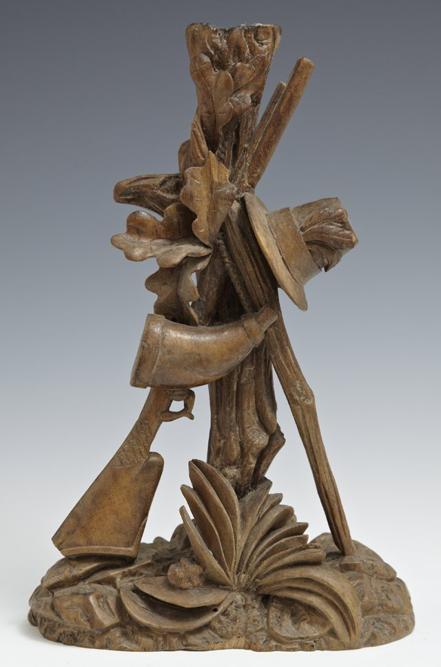 Black Forest Carved Walnut Candlestick, 19th c., in a