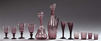 Fifty Nine Piece Set of French Amethyst Glass Stemware