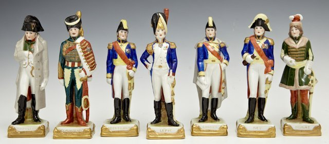 Set of Seven Polychromed Porcelain Figures, 20th c., of
