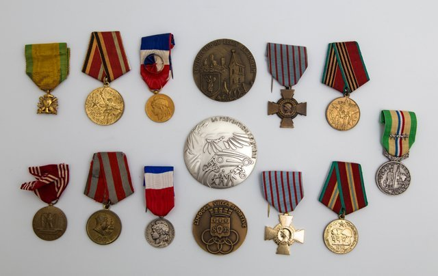 Group of Fourteen Medals and Medallions, 20th c.,