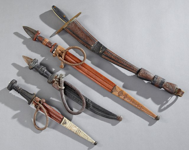Group of Four Moroccan Daggers, 20th c., in leather