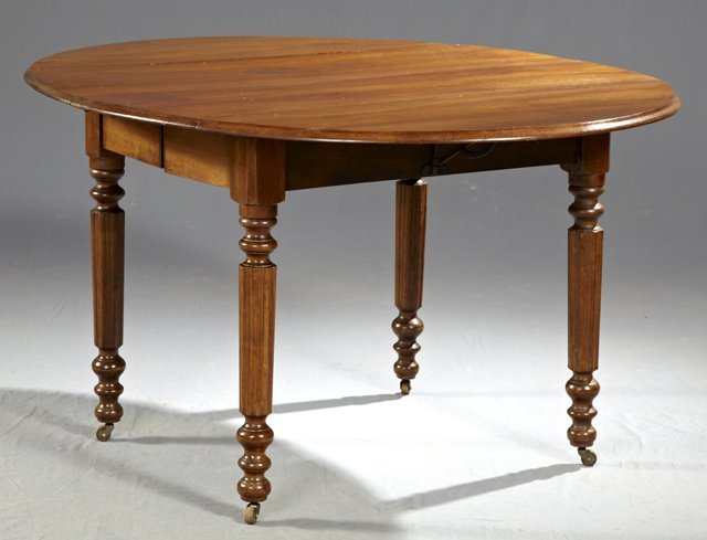 American Carved Mahogany Drop Leaf Oval Dining Table,