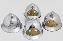 Group of Four French Steel Firemans Helmets 20th c