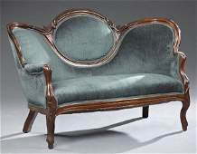 American Victorian Carved Walnut Settee, late 19th c.,