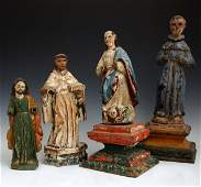 Group of Four Polychromed Carved Wooden Santos 19th
