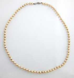 Strand Of 6.5 Mm White Cultured Pearls, With A 14k