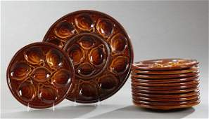 Thirteen Piece Ceramic Oyster Set 20th c by St