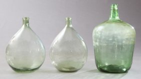 Group Of Three Mold Blown Green Glass Wine Carboys,