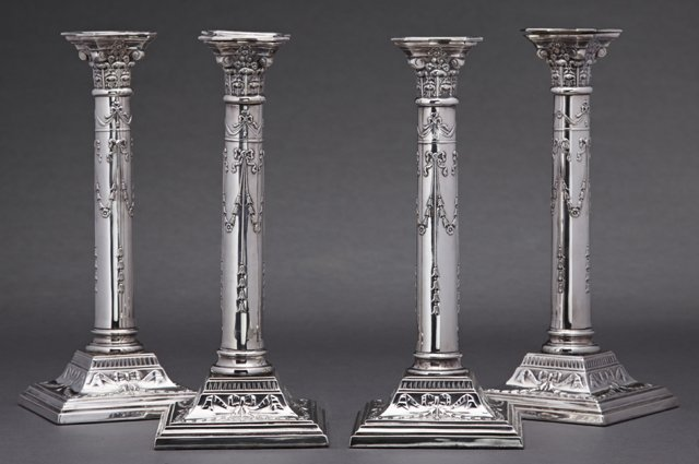 Set of Four English Silverplated Candlesticks, 20th c.,