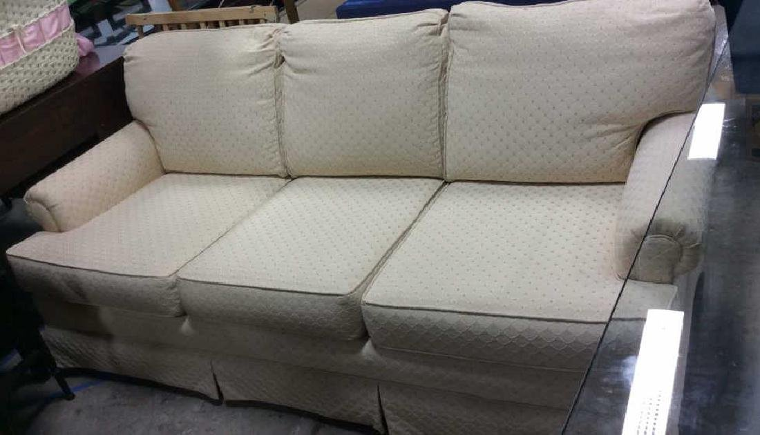 Conover Cream Upholstered Sofa Upholstered sofa in off