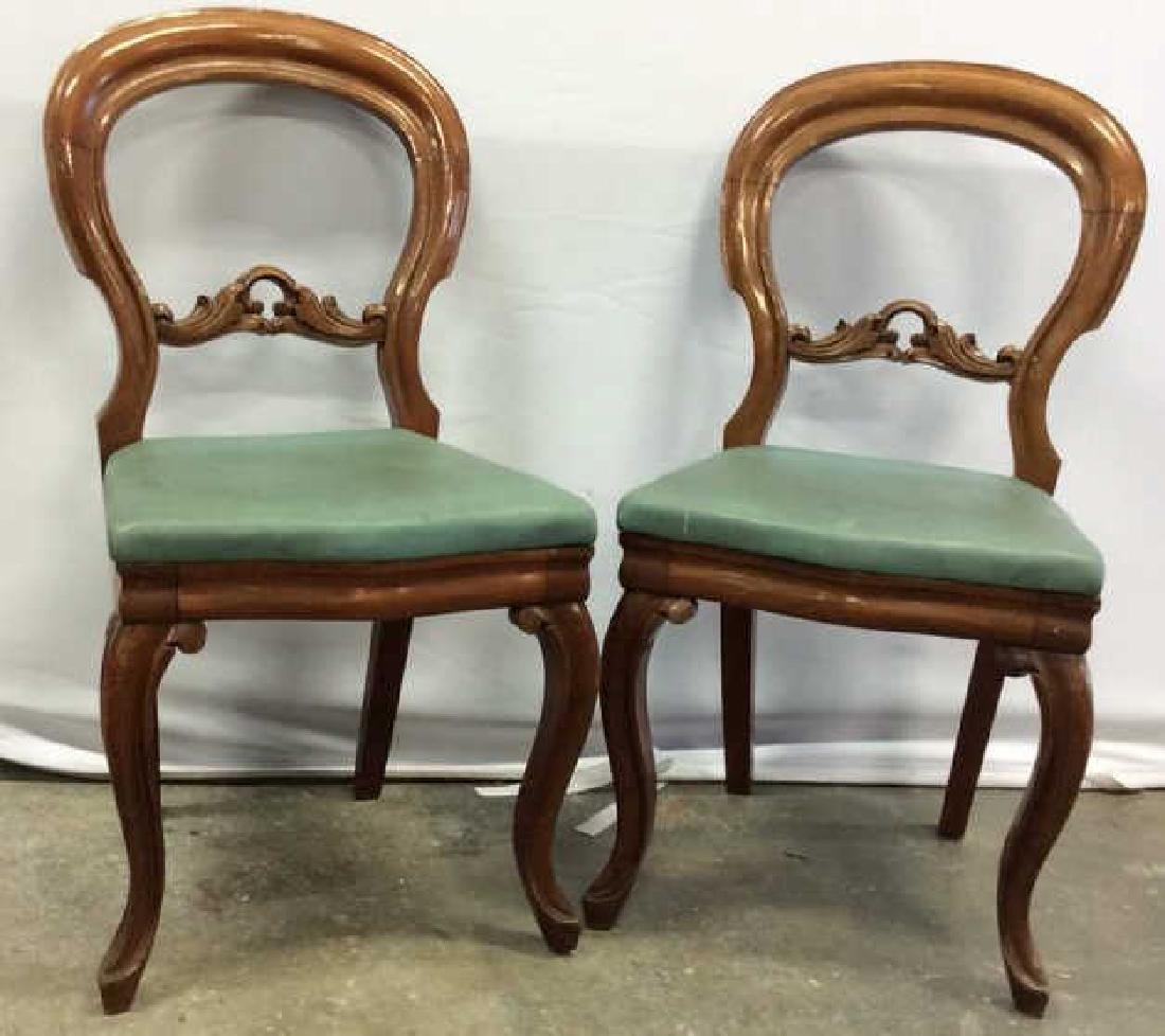 Pair carved Walnut Balloon Back Chairs Carved side