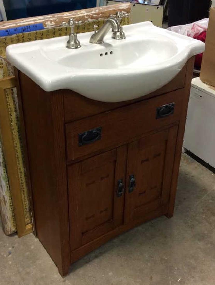 Porcelain sink  with fixtures set in Vanity Cabinet - 2