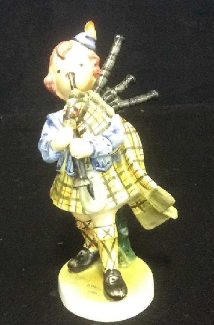 Scottish Boy Figurine Hand Painted in Matte Bisque