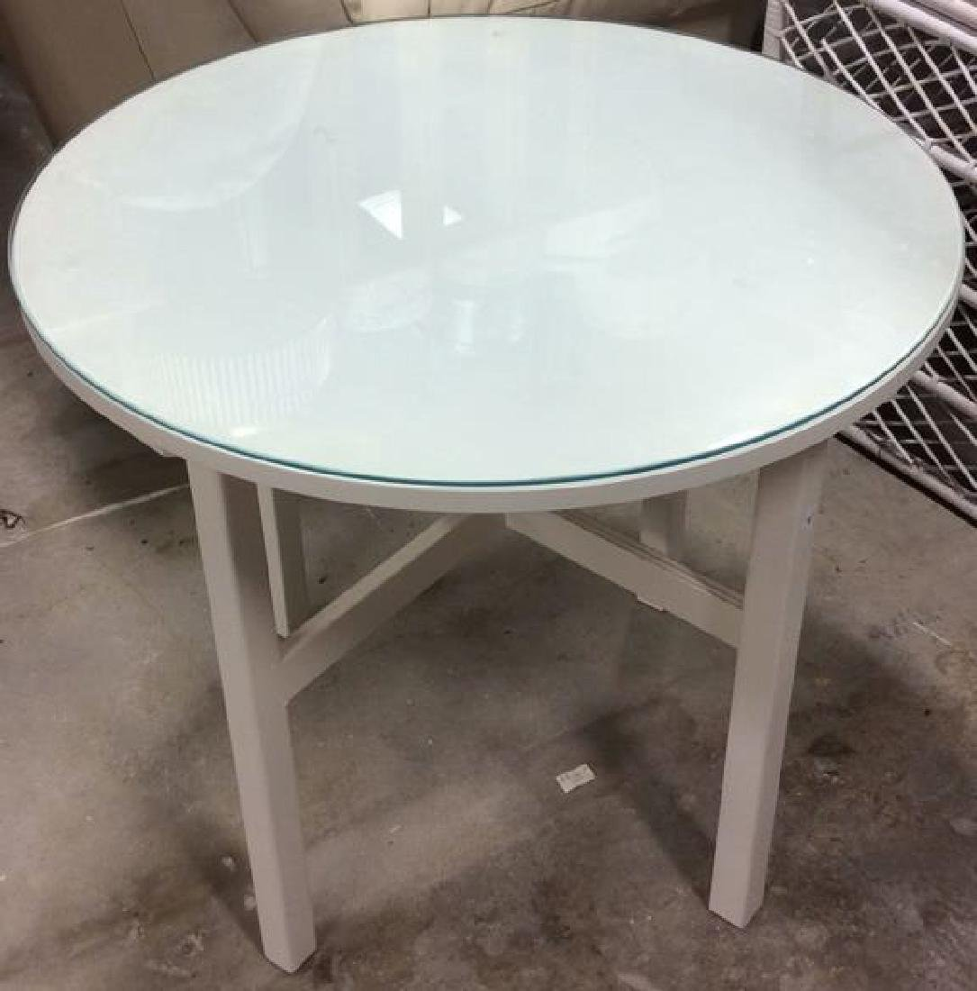 Circular White Wood Table Glass Top White Wood and no