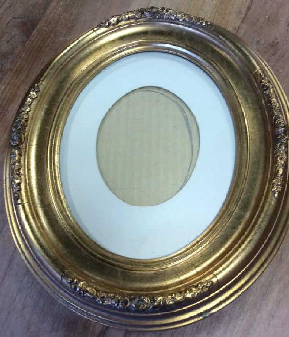 Antique Gold Leafed Oval Frame Carved wood frame with