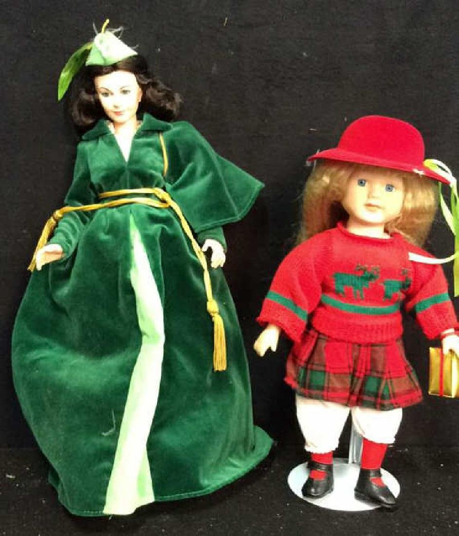 2 Collectible Dolls Painted Porcelain and Costumed