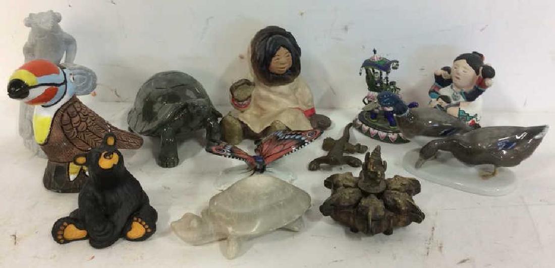 Group around the globe figurines