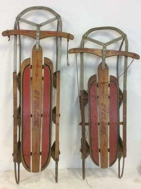 Two Wooden Cyclone Snow Sleds