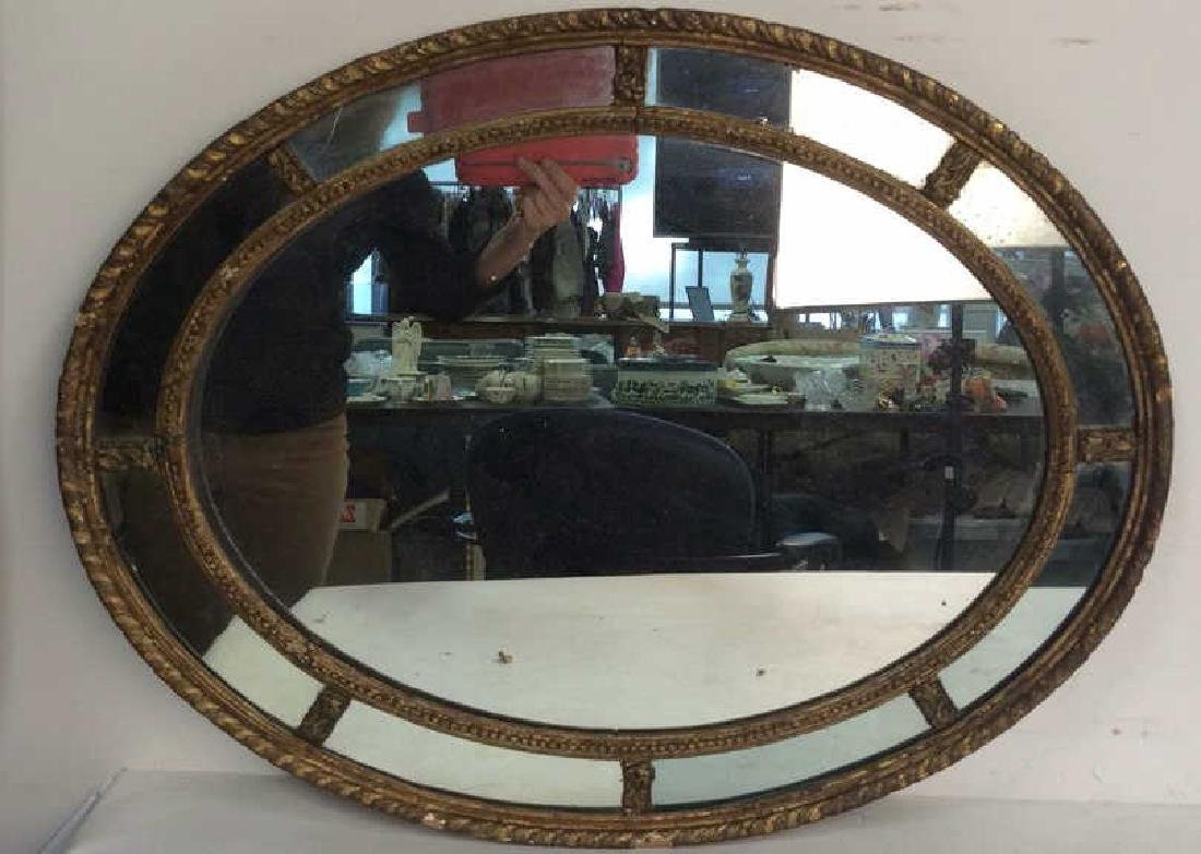 Antique Carved Gilded Oval Mirror