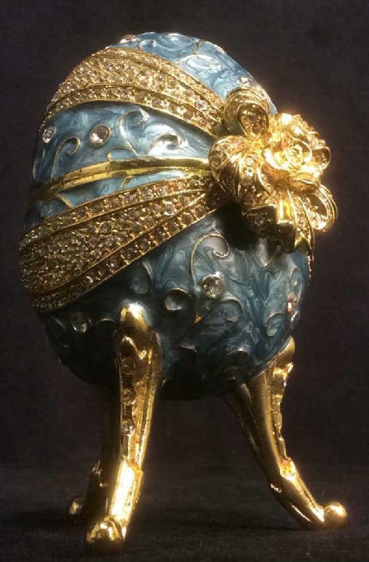 Ornate Gold & Sky Blue Toned Egg Music Box