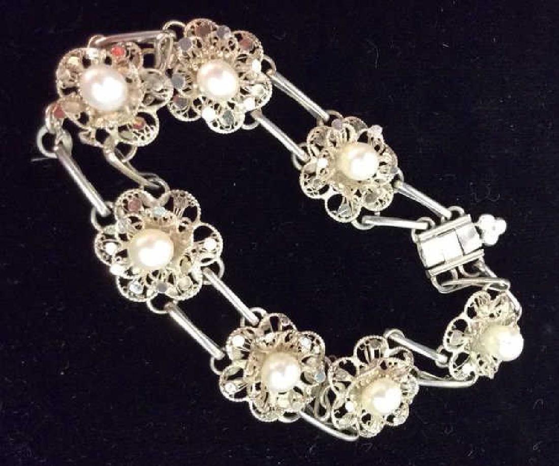 Silver Toned Metal Floral Design Bracelet W Pearls