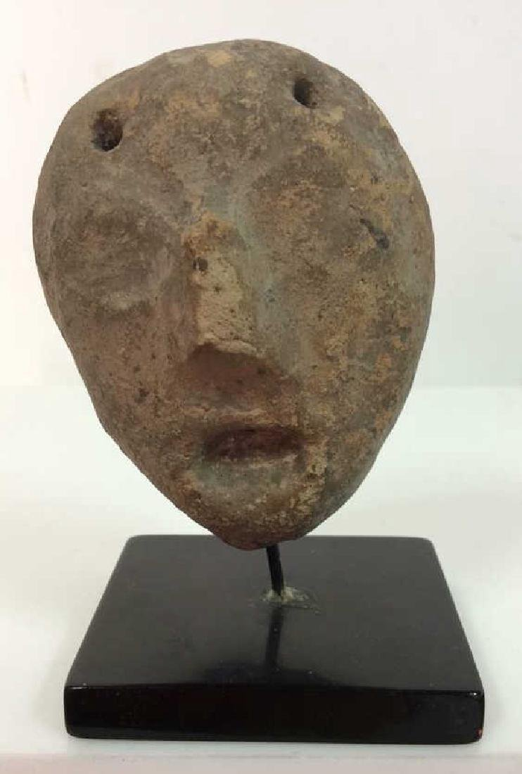 Carved Stone Face Figural