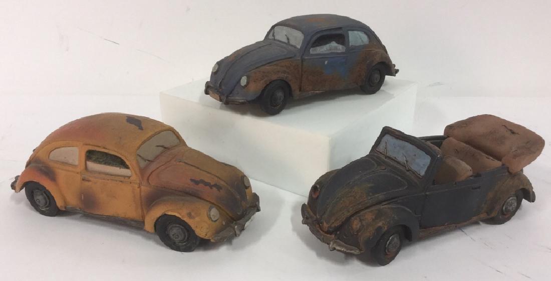 Lot 3 Painted Plaster VW Beetle Car Sculptures