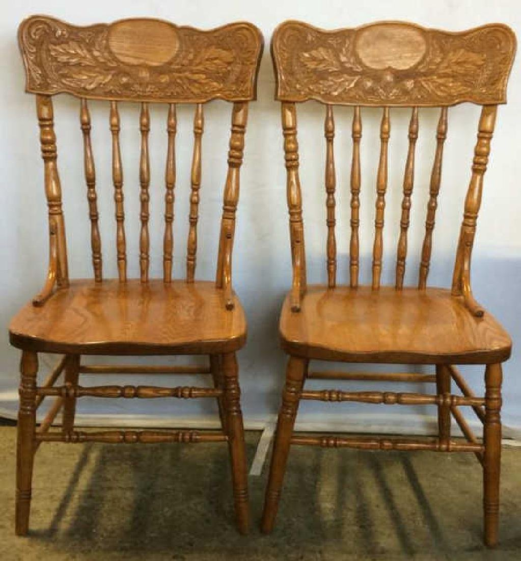 Pair Intricately Carved Wooden Spindle Back Chairs