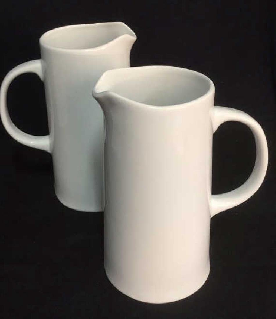 Pair Of Threshold White Porcelain Pitchers