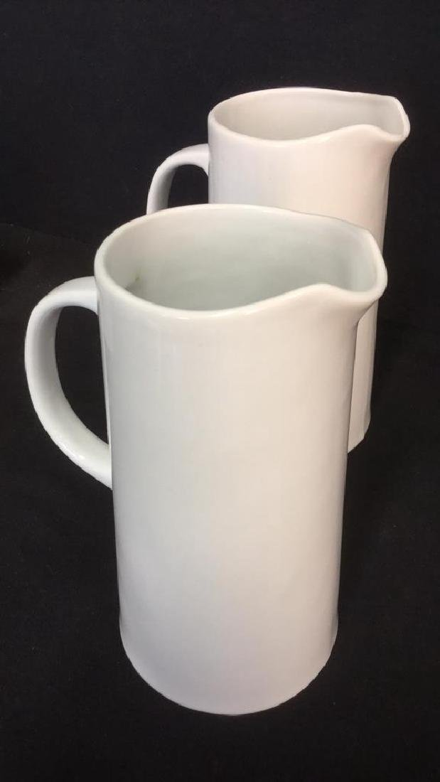 Pair Of Threshold White Porcelain Pitchers - 4