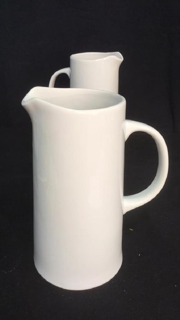 Pair Of Threshold White Porcelain Pitchers - 8