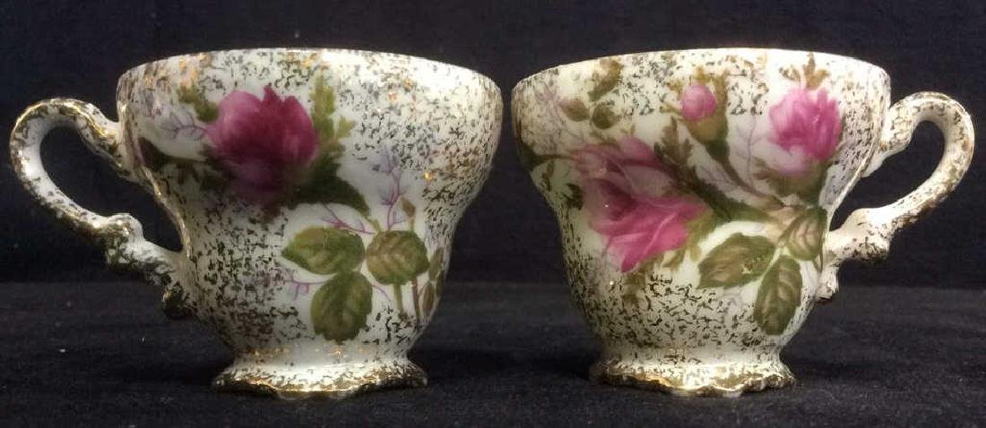 Pair Intricately Detailed Porcelain Teacups