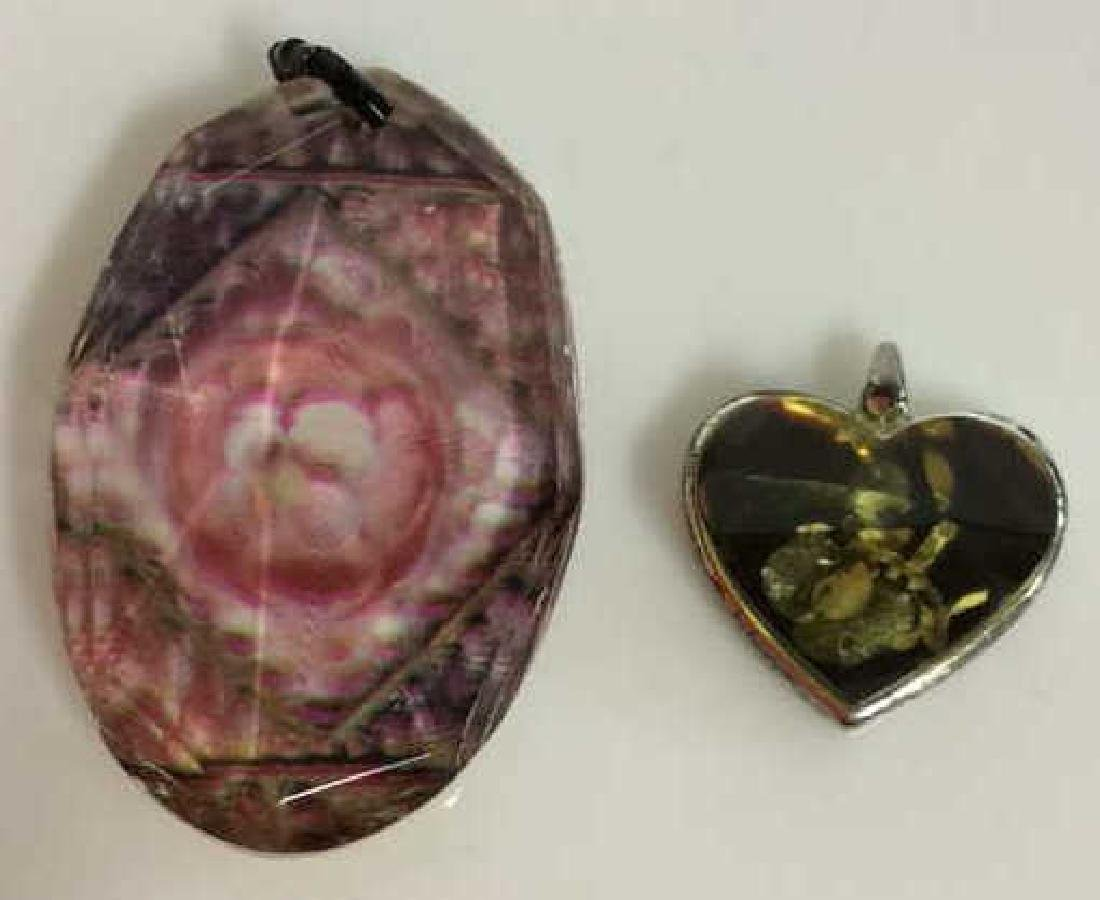 Lot 2 Resign Pendants with Floral Designs