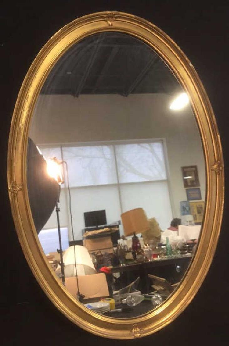 Oval Shaped Gold Toned Wall Mirror
