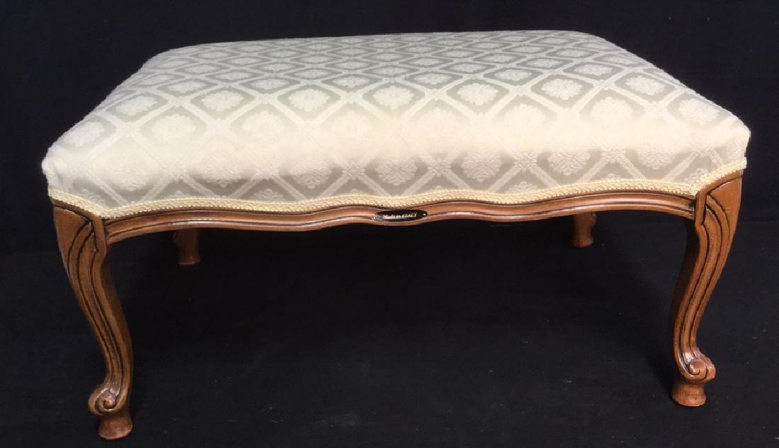 Upholstered Italian Ottoman With Carved Legs