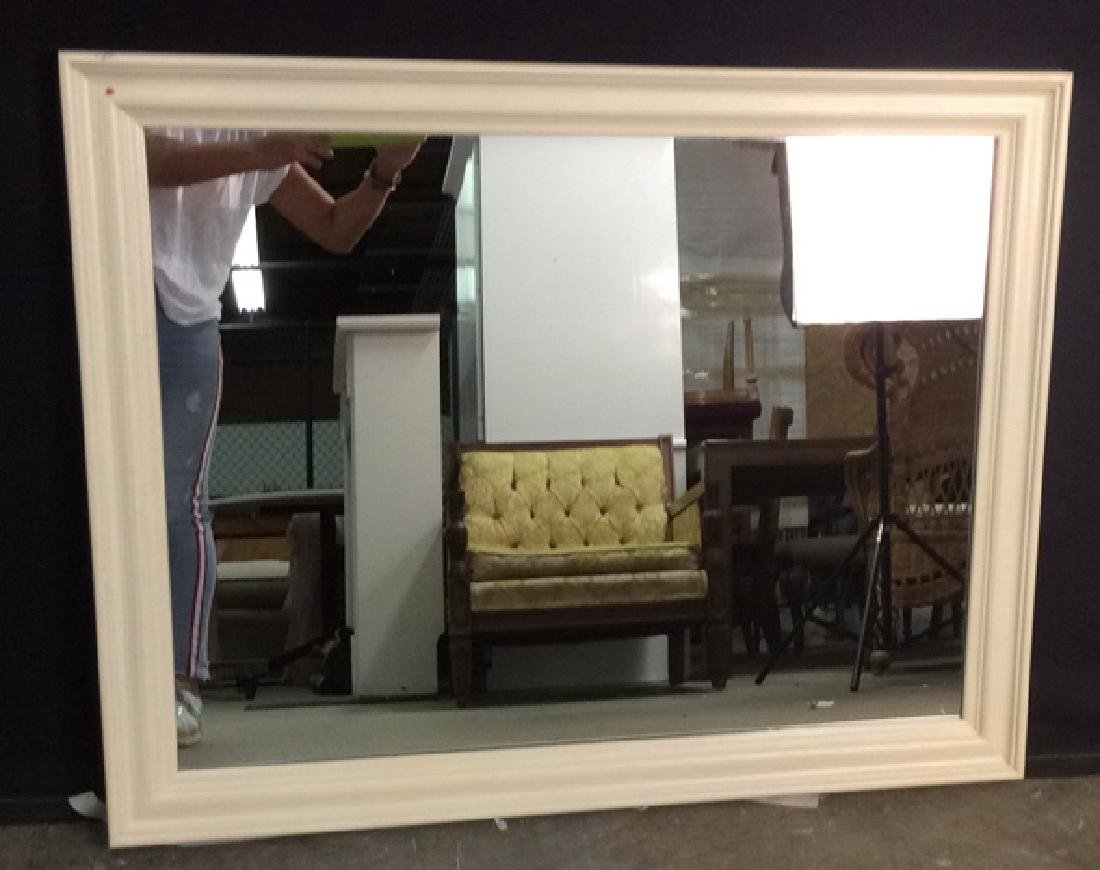 cream toned rectangular wooden frame mirror