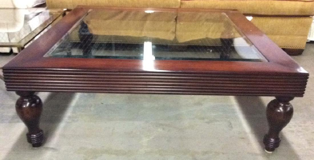 D and D Building mahogany glass top coffee table