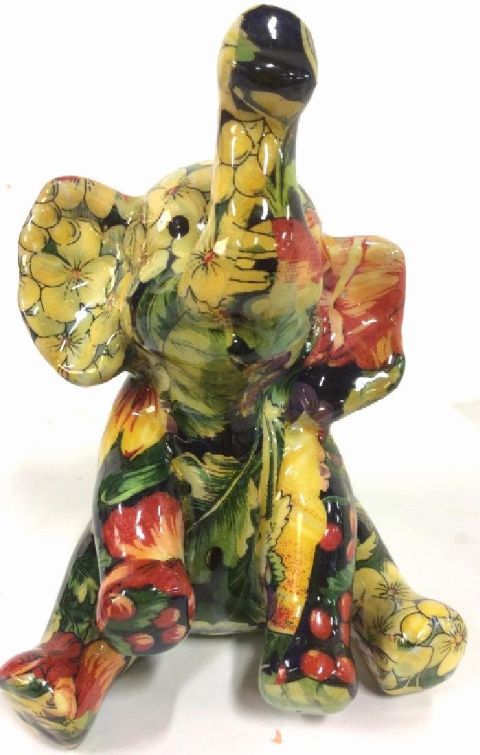 Sitting Baby Elephant Figurine