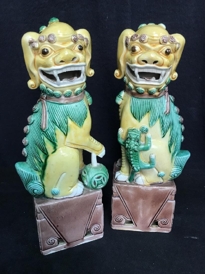 Yellow toned Vintage Pair Ceramic Foo Dogs