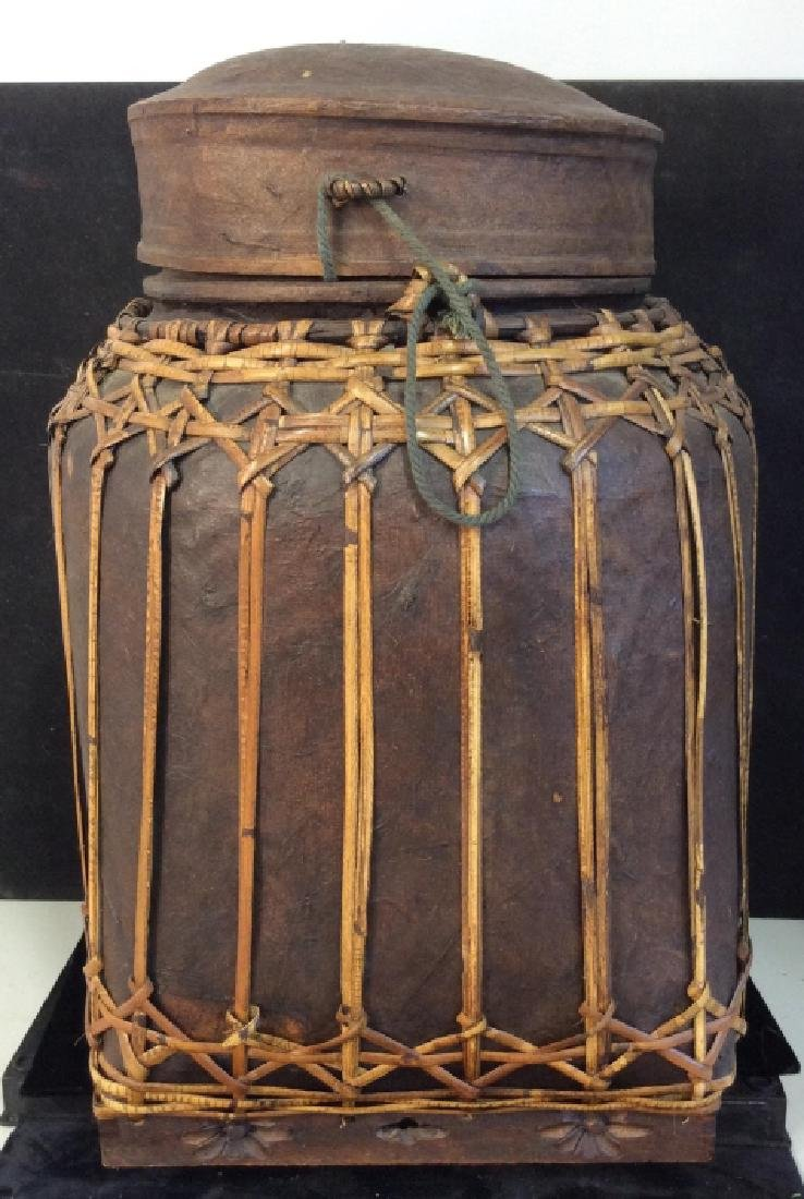 Vintage Asian bamboo covered basket