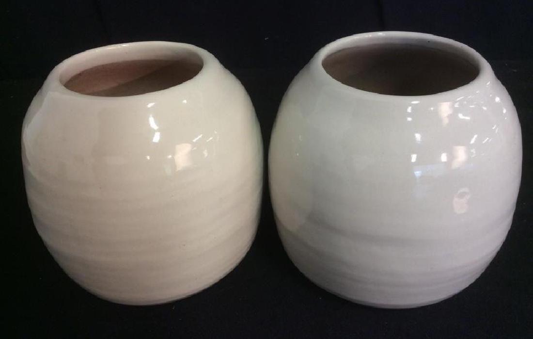 Pair of Cream Tone Ceramic Vases / Planters