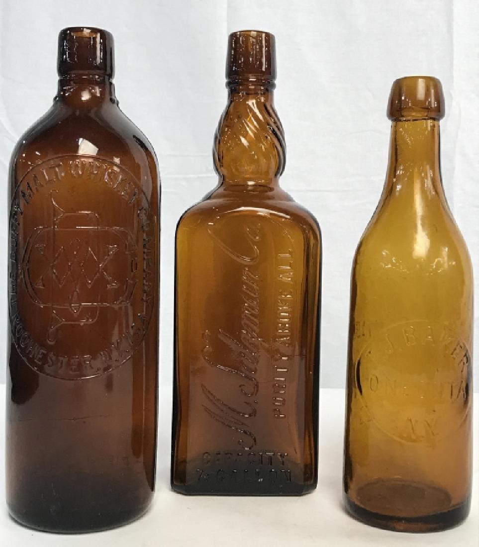 Lot 3 Amber Toned Glass Bottles