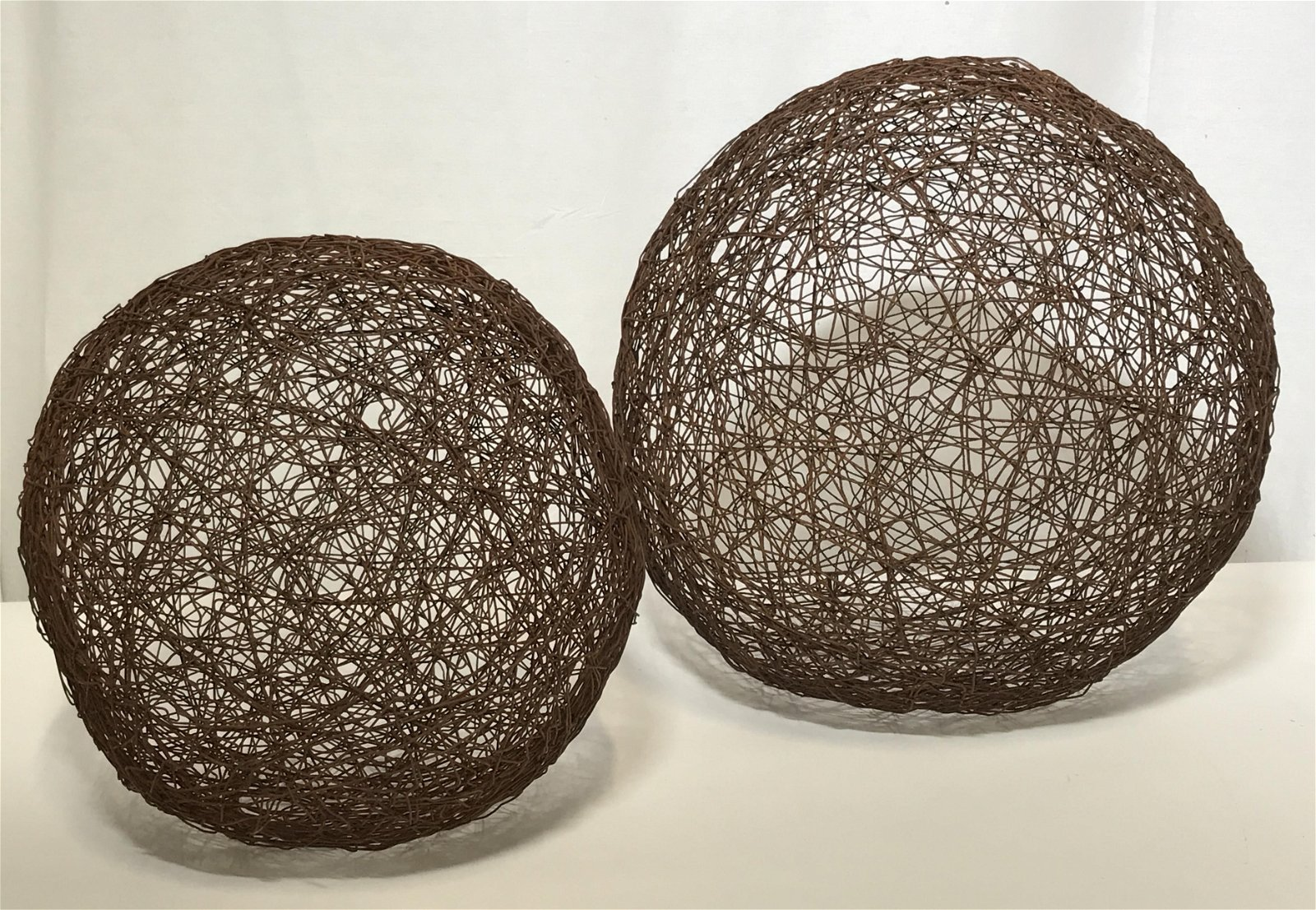 Pair of Metal Wire Spherical Structures
