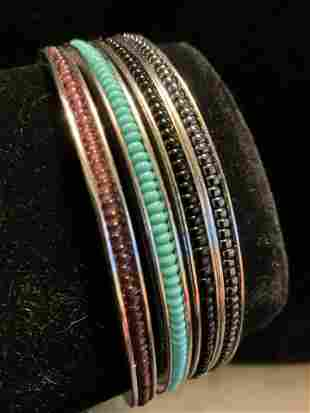 Set 4 Silver toned and Bead Bangle Bracelets