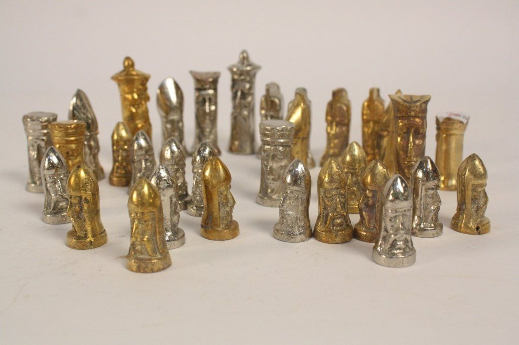 Two sets of Brass and Silver Cast Chess Sets