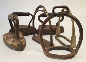 Four Antique Irons And Three Stirrup
