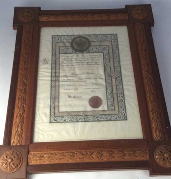 Carved and inlaid multi wood framed document